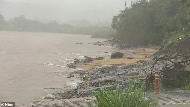 Residents in parts of North Queensland have been warned heavy rainfall could lead to flash flooding. Pictured, Cyclone Kimi makes its presence felt in the Townsville region
