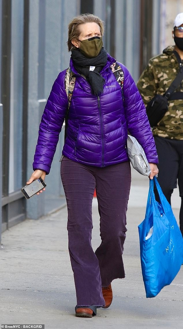 Races: She's set to star in a Sex And The City reboot for HBO Max and on Monday Cynthia Nixon stood out from the crowd in New York City in a purple quilted jacket and purple flares