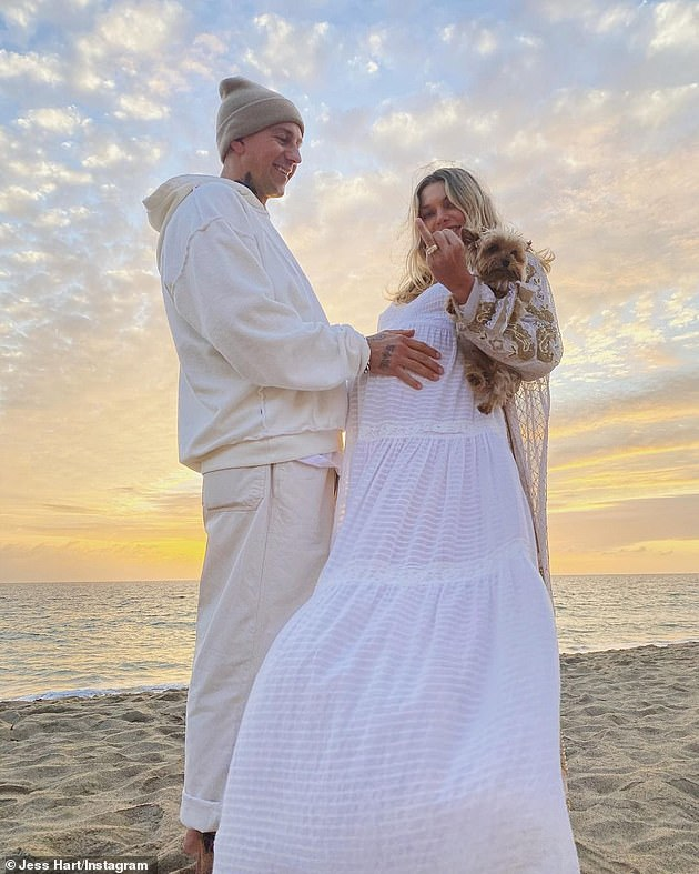 It's official!  In October, James proposed to the model in front of his family and friends at their seaside baby shower in Malibu, Calif.