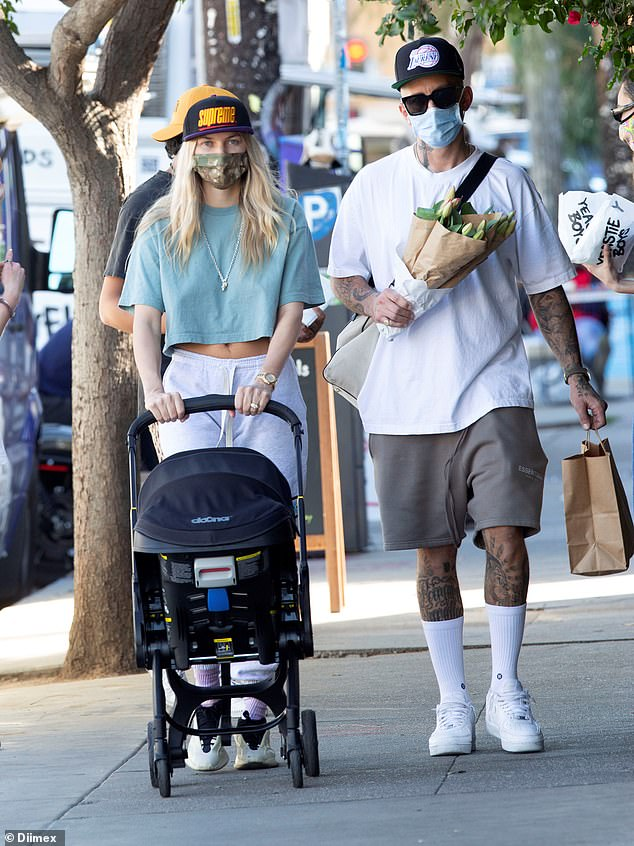Jessica Hart enjoys a stroll with her daughter Baby Rae and her fiancé James Kirkham