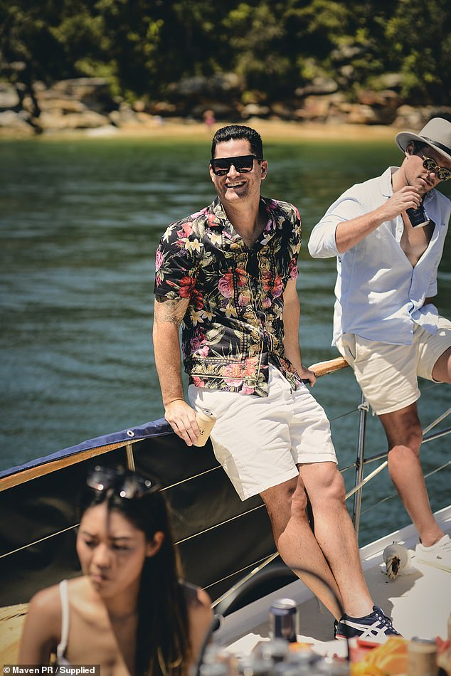 Relaxed: Jamie looked relaxed and summery in a black floral shirt and shorts