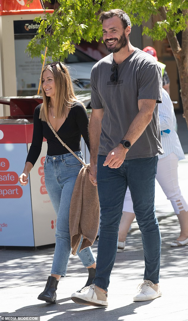 Say cheese! The Perth-based Bachelor couple were seen strolling hand-in-hand at Rundle Mall as they filmed content for their travel-themed social media pages