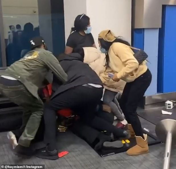 The fight broke out after a dispute over a bag at Detroit Metro Airport