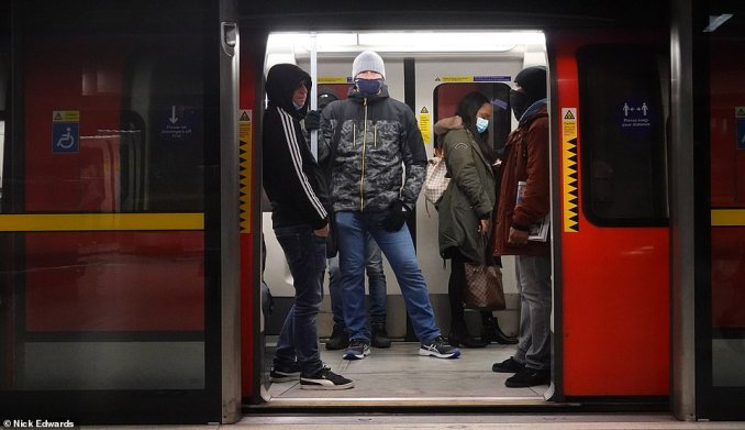 Passengers wait for the doors to close on board on a Jubilee line train at Canada Water Underground Station this morning
