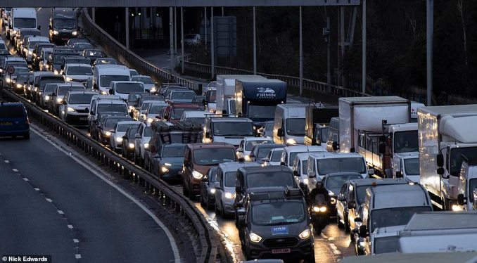 Heavy traffic on the Blackwall Tunnel southern approach road in South East London during rush hour this morning