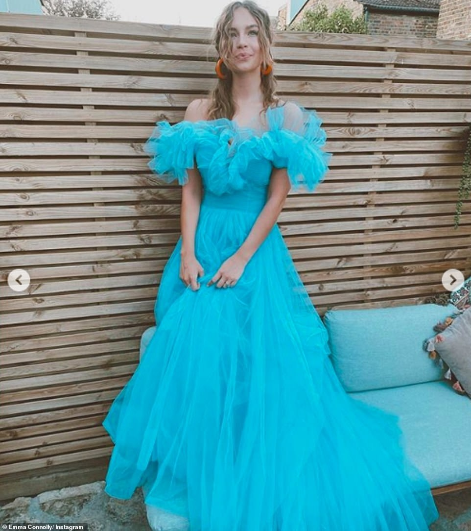 Her something blue:Emma looked radiant in the images as she donned a billowing baby blue tulle gown and matching veil