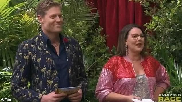 Pushing: IAC host Chris Brown (L) stirred Paulini Curuenavuli by mentioning Idol judge Ian 'Dicko' Dickson - nearly 14 years after he made those scathing 'gold dress' comments
