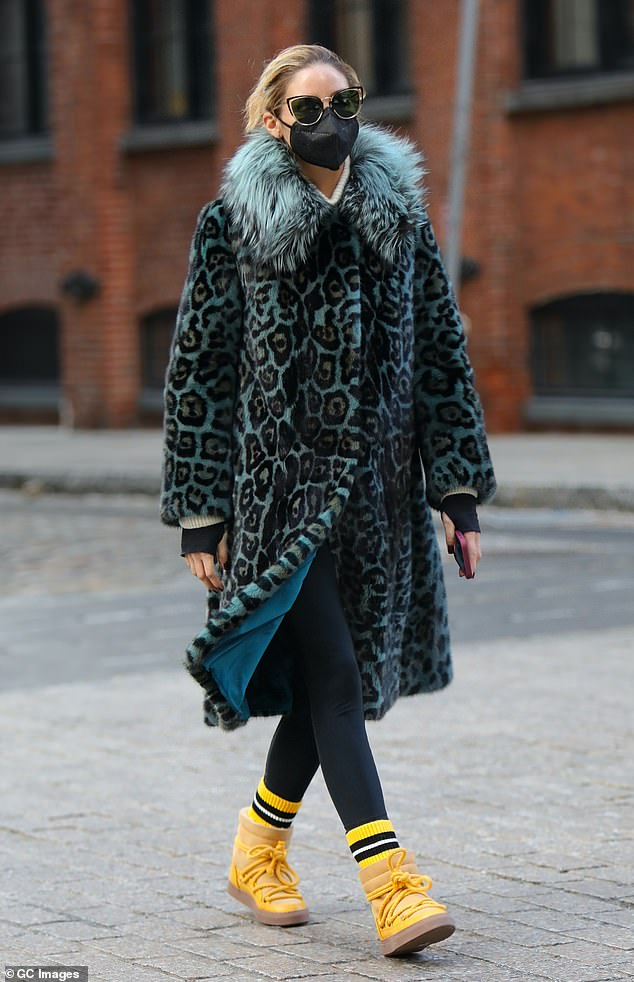 Looks great: Olivia Palermo put on a very stylish display in a light blue leopard print coat and a pair of bright yellow boots as she enjoyed a stroll through her Brooklyn neighborhood