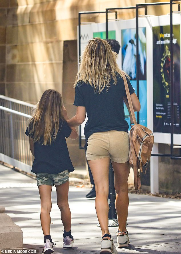 Gorgeous: She wore her blonde locks in a natural wave and appeared in a good mood as she entered the museum with little India, whom she shares with her husband Chris Hemsworth