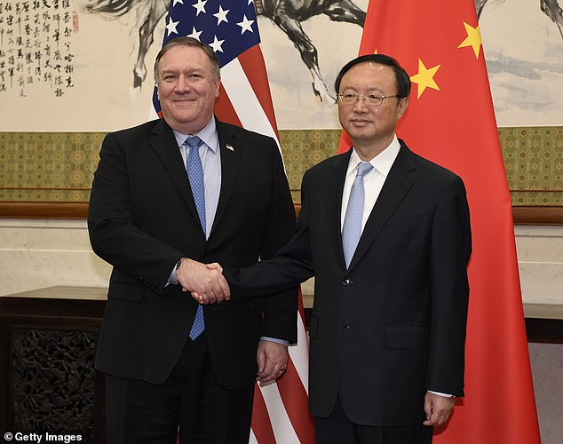 Pompeo, pictured in October 2018 with State Councillor Yang Jiechi in Beijing, was sanctioned on Wednesday by China and accused of having 'seriously disrupted China-U.S. relations'