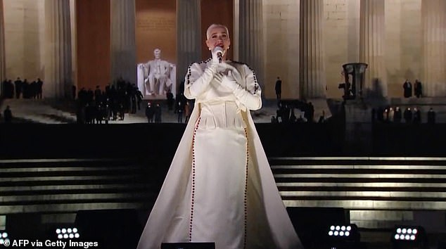 America the Beautiful: A dazzling spectacle of red, white and blue fireworks surrounded the obelisk as Katy sang the song, wearing a hooded patriotic dress