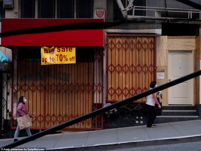 SAN FRANCISCO: A sign advertises a sale on a store that has now closed down