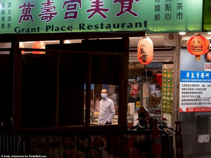SAN FRANCISCO: A customer looks out the window of an empty restaurant in Chinatown in December