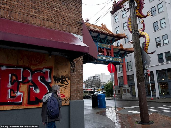 SEATTLE: A boarded up restaurant on an empty corner of one of the eldest Chinatown in the nation