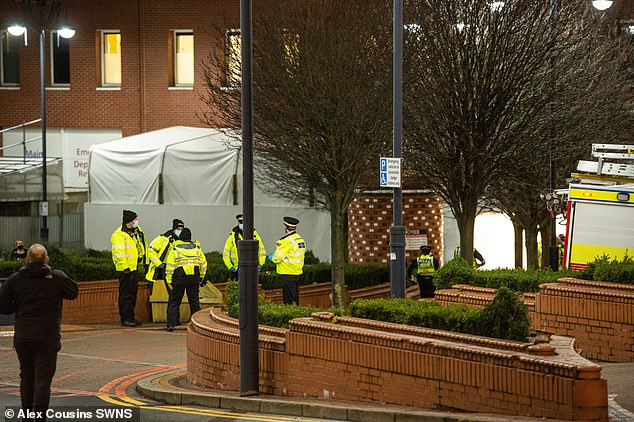 Police were pictured outside the hospital after it was briefly evacuated on Thursday