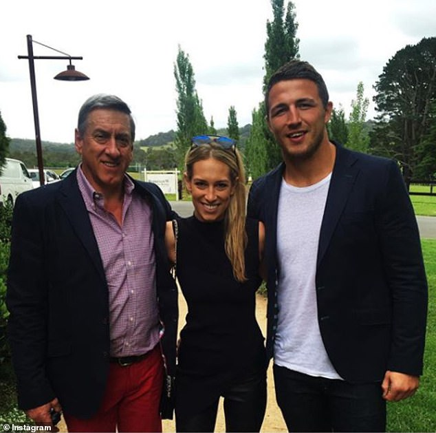 In happier times: Burgess's ex-wife Phoebe and his father-in-law Mitchell Hooke gave statements about Burgess to the media. The three are pictured together