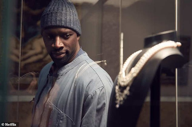 Smash hit: Omar Sy as Assane Diop in Lupin, which premiered this month andis projected to reach 70 million households in its first 28 days - making it one of the biggest Netflix shows ever
