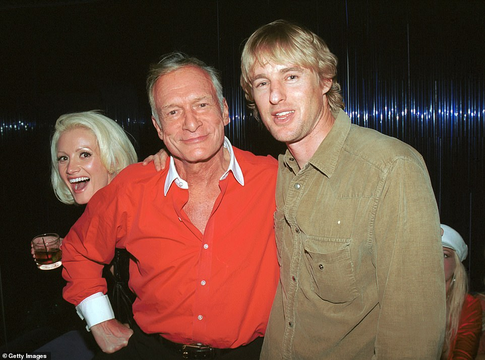 Hobnobbing: Owen Wilson is pictured with Hugh Hefner at the hotel in 2002 - while Girls Next Door star Holly Madison appears in the background
