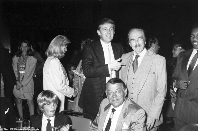 Trump and his father, Fred, standing, and his young son, Don Jr, seated, are pictured at the Plaza in the 1980s