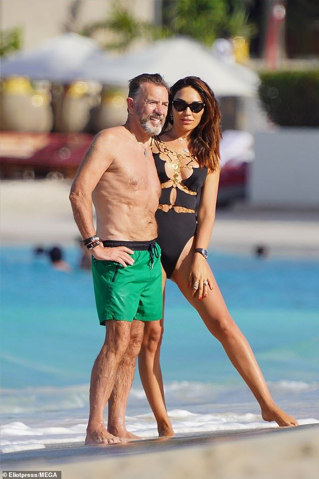 Sunny getaway: Nigora Whitehorn, 40, showed off her slender figure in a plunging black swimsuit as she joined her husband Duncan Bannatyne, 71, on a trip to St. Barthélemy on Friday