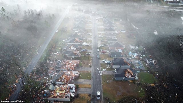 One aerial photo shows at least five homes with extensive roof damage
