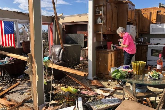 Patti Herring, pictured, and her husband Tim ran to their bathroom when they got the warning that a tornado was headed their way