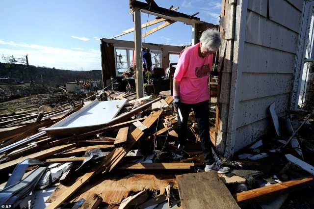 By Tuesday afternoon, blue skies and sunshine illuminated the damage left by Monday's deadly tornado