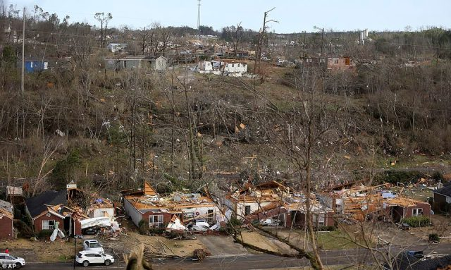 The tornado carved a 10-mile path of destruction through the northern suburbs of Birmingam on Monday