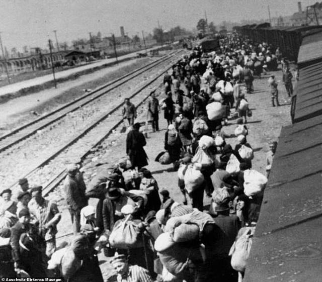 A transport of Jews hold their belongings shortly after arriving at Auschwitz-Birkenau. Many of these Jews were deported from Berehovo, near Hungary's border with what is now Ukraine. This photograph was taken from the album belonging to SS officerBernhardt Walter, who was head of the Auschwitz photographic laboratory known as Erkennungsdienst (identification Service). The album was made to be presented to camp commandantRudolf Hoss