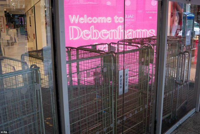 A closed entrance to the Debenhams flagship store on Oxford Street in London, which is now permanently shut
