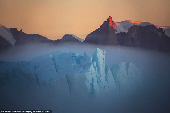 This amazing shot by Vladimir Alekseev shows a very rare natural phenomenon - fog over an iceberg. The picture was taken in Greenland