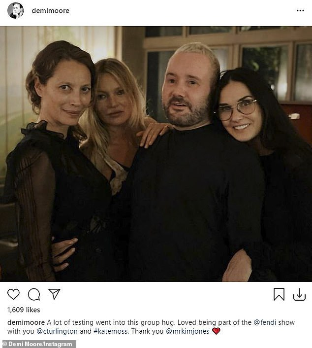 So many stars: Christy, far left, with Kate Moss, Kim Jones and Demi Moore