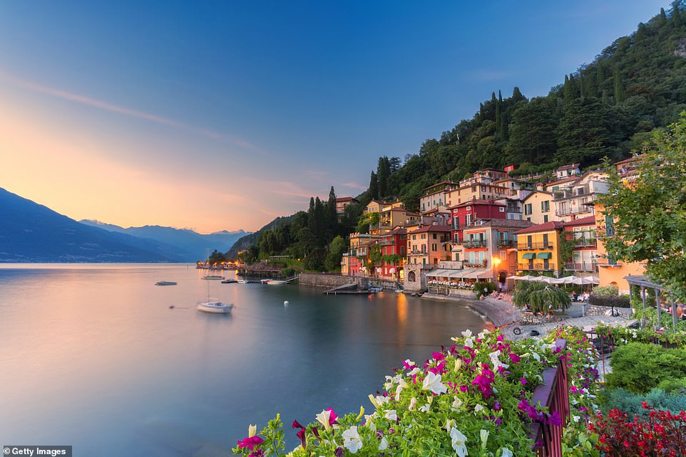 It is unclear whether holidays to Italy will go ahead this summer, but tourism minister Dario Franceschini says 'Italian tourism will return very quickly' after the pandemic. Pictured is the stunning village of Varenna on the shores of Lake Como