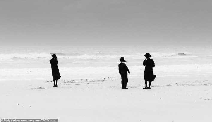 This is the winning entry in the 'best single image/people of the world portfolio' category. It was taken by Belgian Eddy Verloes. He said: 'This is part of my series Losing Our Minds, which was taken at the beginning of the Covid crisis in 2020. This is a photo of ultra-Orthodox Jews who were enjoying their freedom in an unorthodox way in the storm (of their lives) and escaping the lockdown'