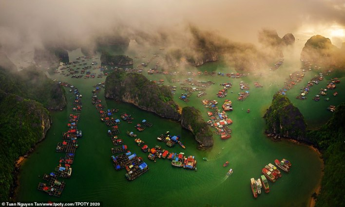 A stunning commended image of Lan Ha Bay in Vietnam by Vietnamese photographer Tuan Nguyen Tan. The bay is home to an archipelago of around 400 islands