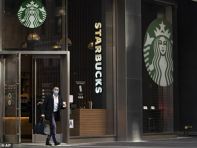Robinhood restricted purchases of 50 different stocks, including Starbucks, on Friday. Above, a customer leaves a New York Starbucks earlier this month