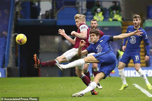 Chelsea's Marcos Alonso scores his side's second goal during the English Premier League soccer match between Chelsea and Burnley at Stamford Bridge Stadium in London, England, Sunday, Jan. 31, 2021.(Julian Finney/Pool Via AP)