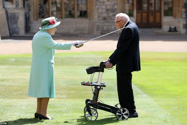 Captain Tom receiving his knighthood from Queen Elizabeth II during a ceremony at Windsor Castle. He raised almost £33m.