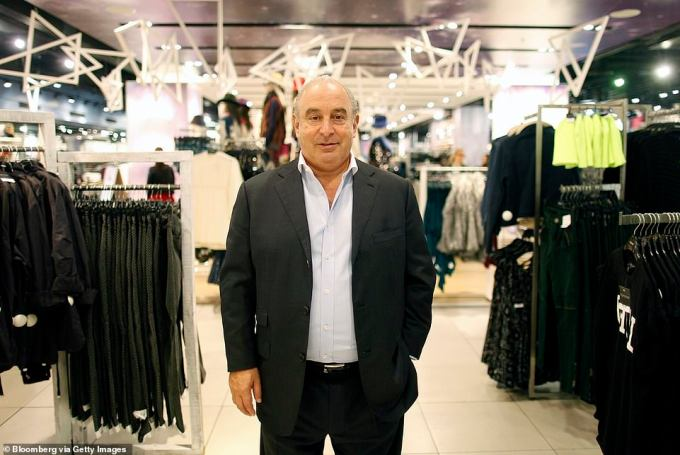 Sir Philip poses for a photograph following an interview inside the Topshop store on Oxford Street in London in 2012