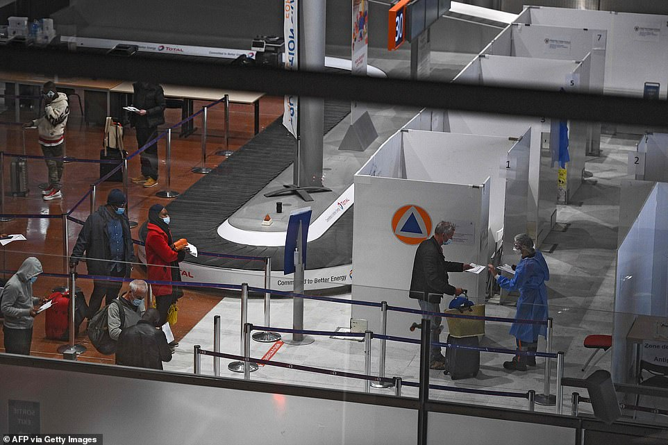 FRANCE: Travellers present their documents at a Covid-19 testing center at Roissy Charles-de-Gaulle Airport in Paris