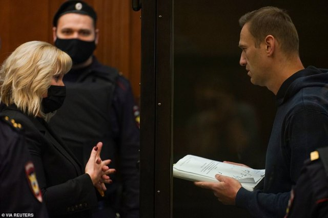 Navalny speaks with his laywer ahead of the sentencing hearing