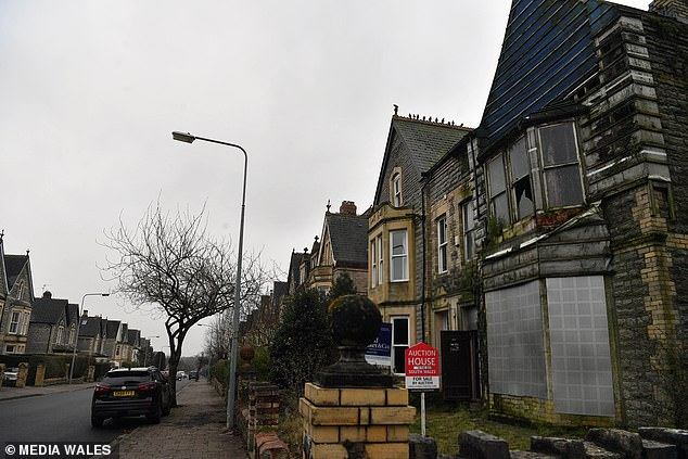 The three-storey semi-detached, seven-bedroom property on Westbourne Road in Penarth, Vale of Glamorgan has been battered by the elements - so much so that a significant portion of the front facade has literally fallen off