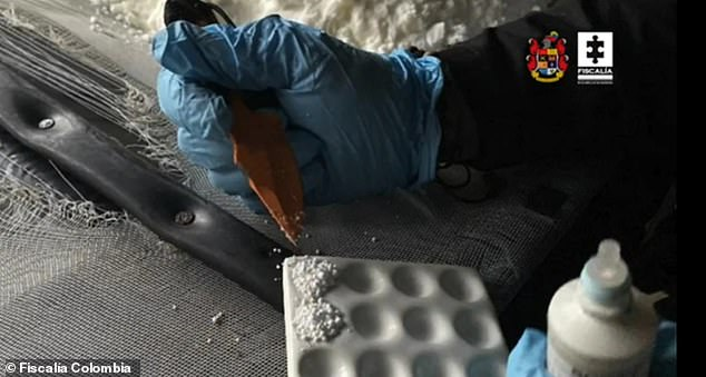 An agent with Colombia's intelligence agency does a test on a tiny portion of the 2,800 kilos that were seized from a clandestine lab