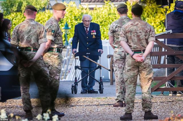 Members of the armed forces watched as the grandfather-of-four carried out the final length of his 100-lap challenge in the back garden of his home last April. During the walk he turned to the TV crew across the lawn and said with a twinkle: 'I can't believe all this fuss is for me– and only because I went for a little stroll!'