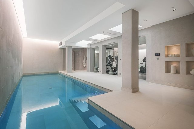 The heated swimming pool is in the basement of the former church, with an adjoining gym and massage suite already built in