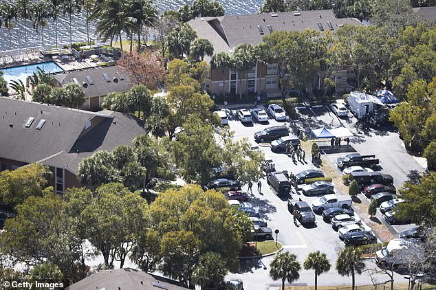 The shooting unfolded at an apartment complex, pictured above, where the man suspected of possessing child pornography lived