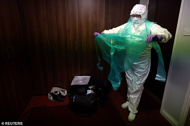 Meanwhile, embalmer Mary Evans (pictured), said she is extra careful moving bodies of Covid victims because she is worried about infected droplets reaching her