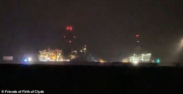 The coastguard received a mayday call to assist the vessel at 7.20pm last night and said the rescue operation was still ongoing today. Pictured: The scene last night