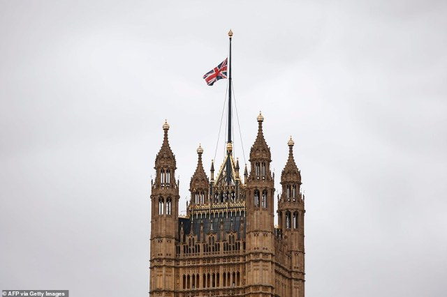 A Union Flag flies at half mast from the top of Victoria Tower at the Palace of Westminster this morning in tribute to the fundraiser