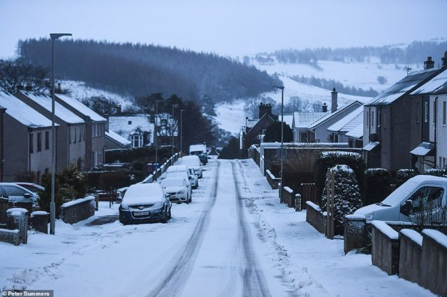 Snow-covered streets at Dufftown in Scotland today as forecasters expect heavy snow and ice will affect many regions